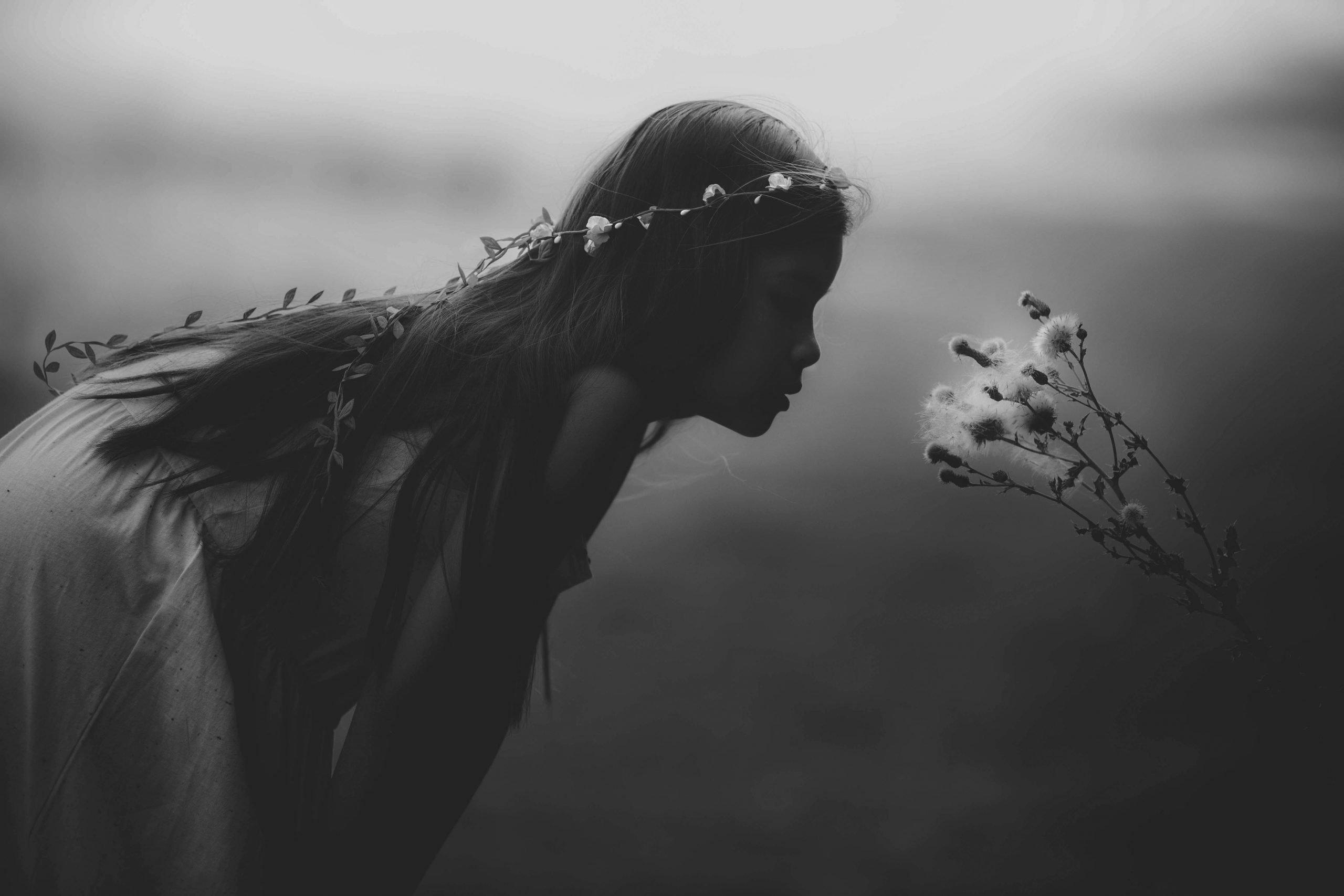 girl smells blossom