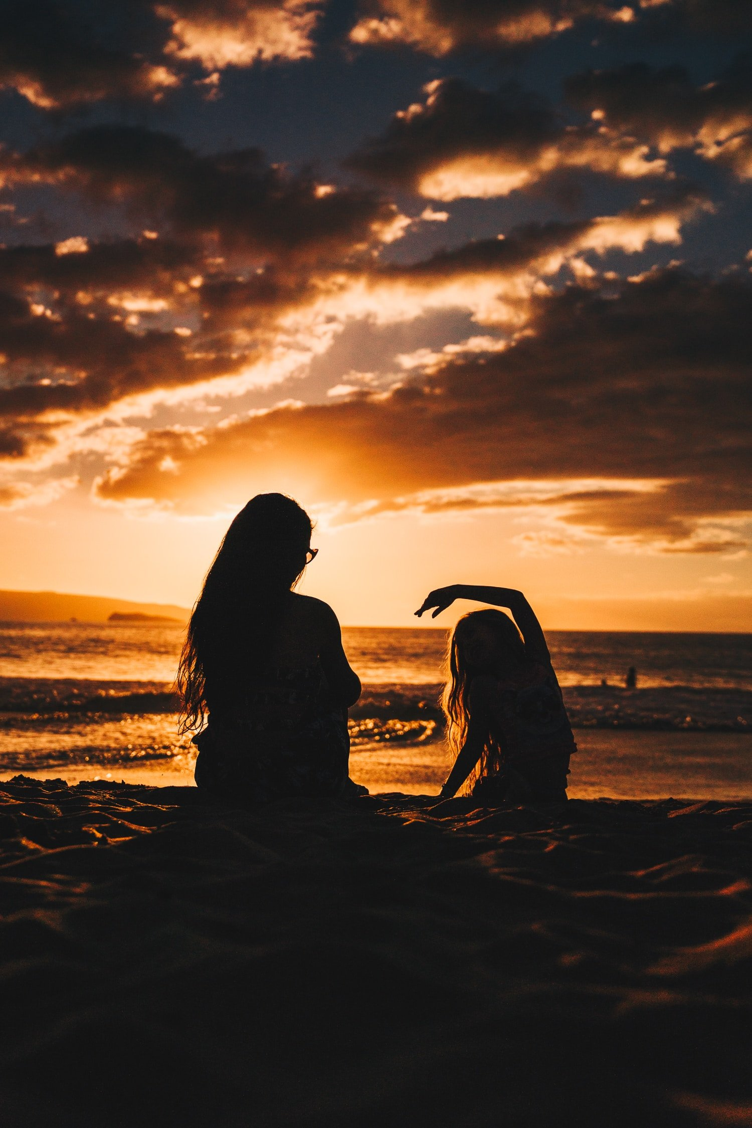 woman and girl in sunset
